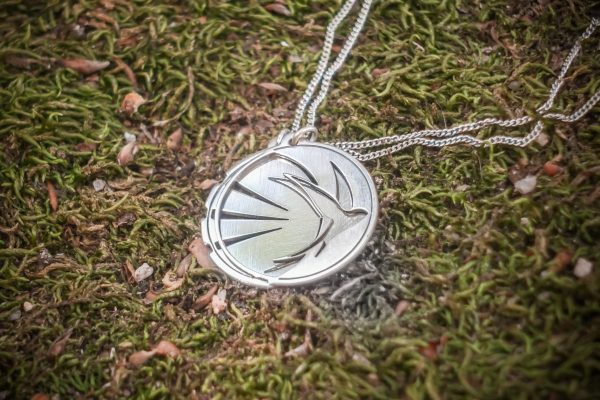 silver moon & sun bird necklace together